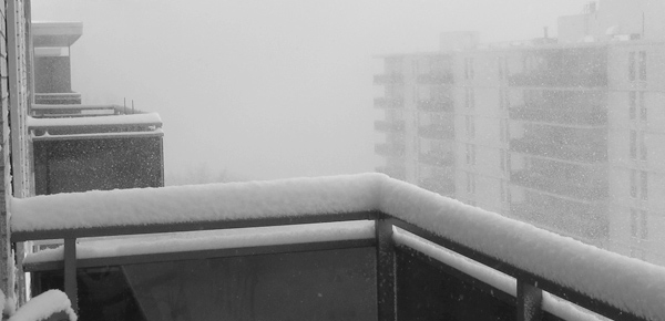 Tower block in snow blizzard