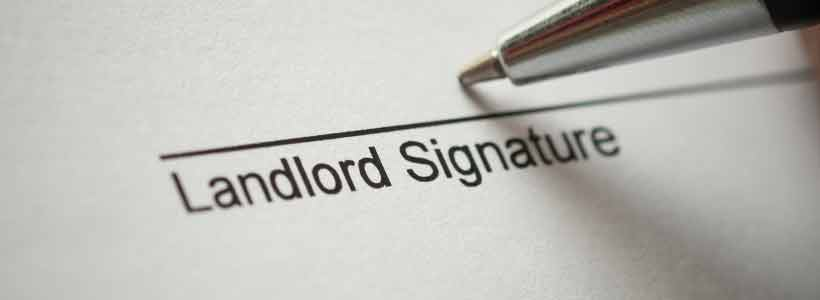 Landlord signature being signed